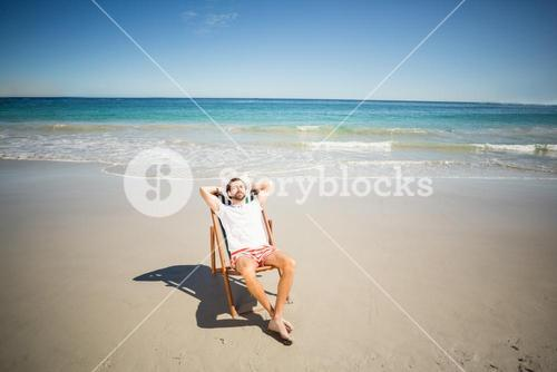 Man relaxing on armchair