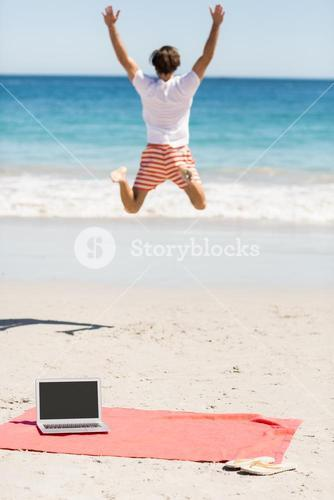 Man jumping on beach