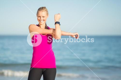 Woman exercising on beach