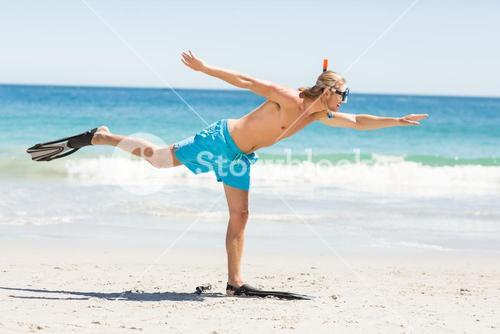 Man posing with diving mask and flippers