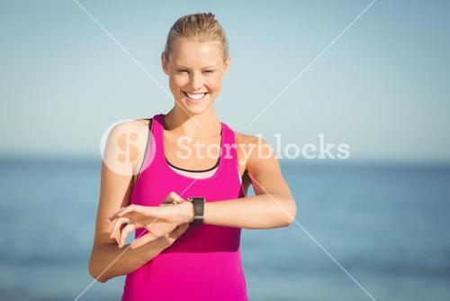 Woman checking time on beach