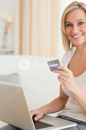 Portrait of cute woman buying online