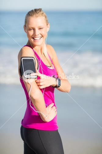 Woman listening music on mobile phone
