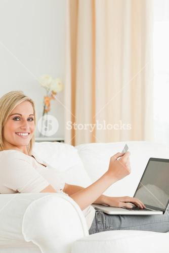 Potrait of charming woman paying her bills online