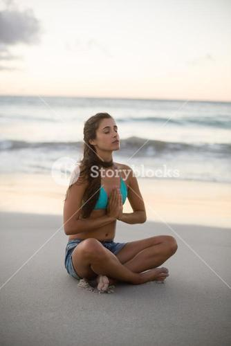Young woman performing yoga