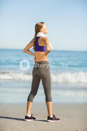 Beautiful woman taking break after exercising