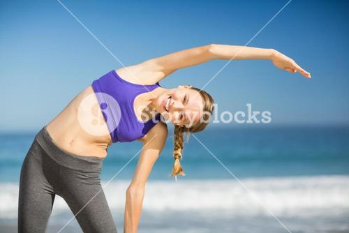 Beautiful young woman exercising