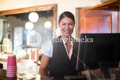 Waitress working on computer at counter