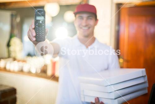 Pizza delivery man holding phone
