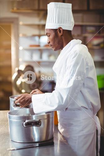 Chef holding cooking pot