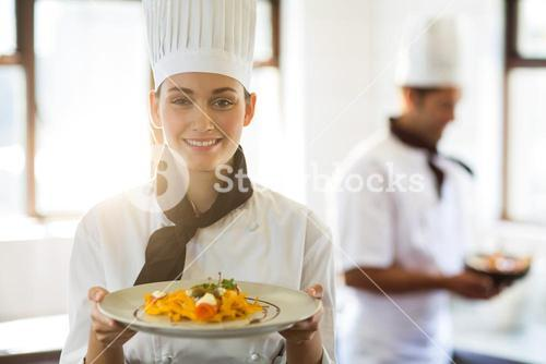 Happy head chef presenting her food