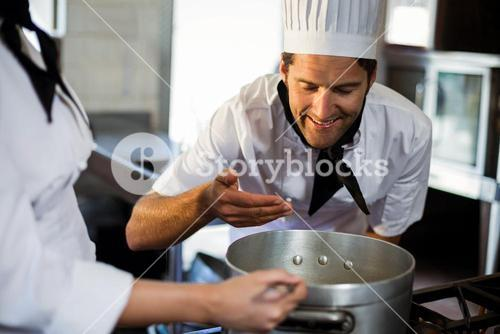 Head chef smelling the food