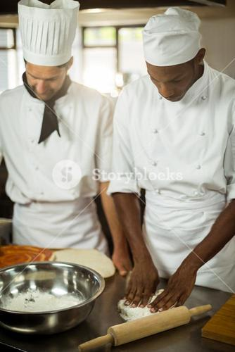 Two chefs making pizza doug