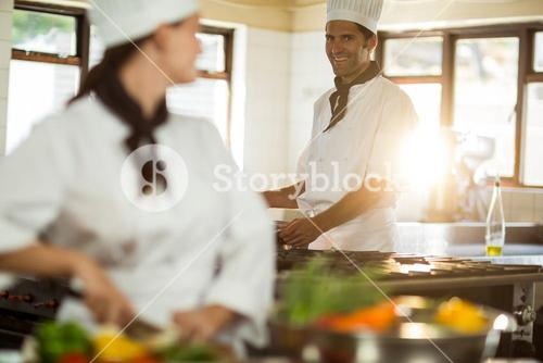 Head chef working with colleague