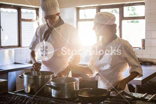 Chefs preparing food at stove