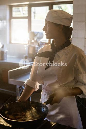 Chef preparing food at stove