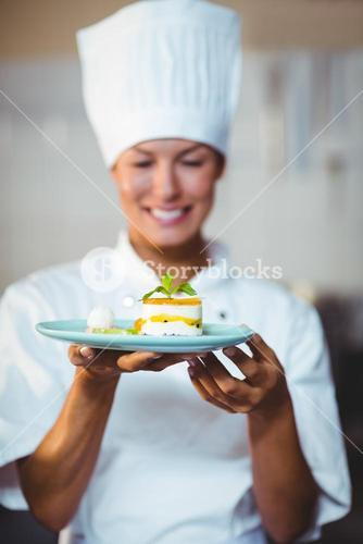 Smiling chef presenting her food