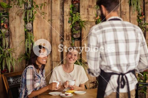Waiter interacting with customers
