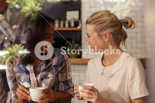 Two customers drinking coffee