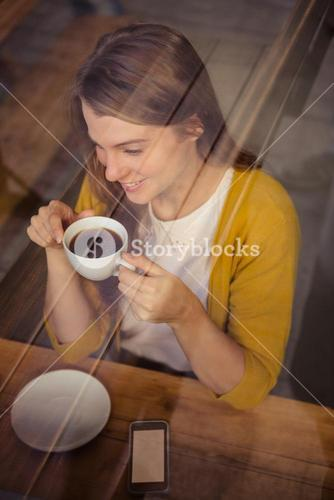 Casual woman drinking a coffee
