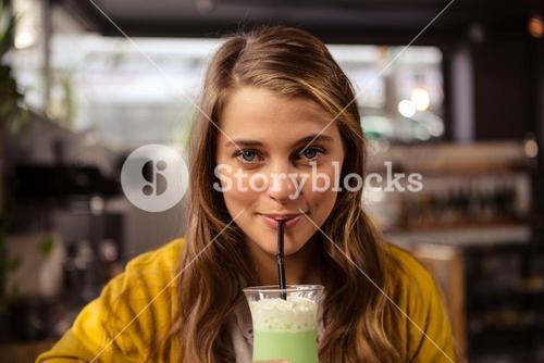 Casual woman drinking a cocktail