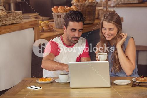 Couple using a laptop
