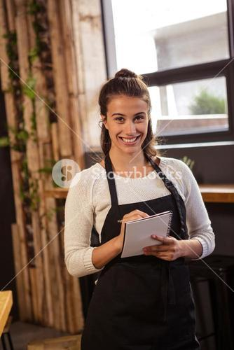 Waitress taking order in cafeteria