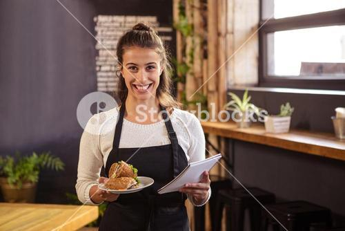 Waitress holding a plate and a clipboard
