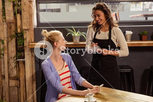 Waitress taking order of a woman