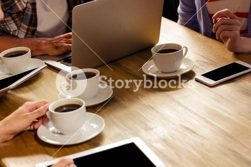 Focus on laptop with coffee