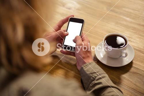 Focus on phone with hands