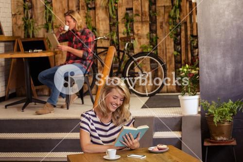 People reading book and using tablet
