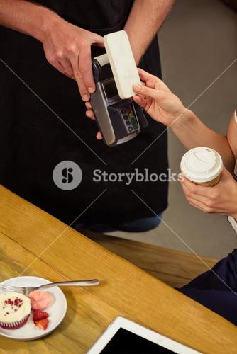 Woman paying with mobile payment