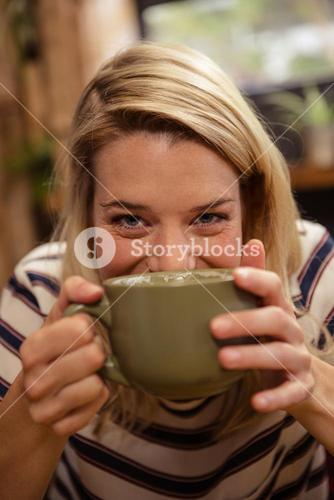 Woman drinking a hot beverage
