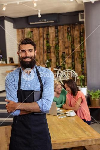 Waiter standing with arms crossed