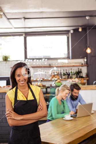 Waitress standing with arms crossed