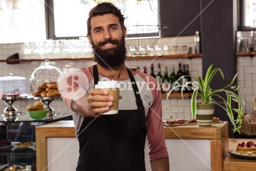 Waiter presenting a disposable cup