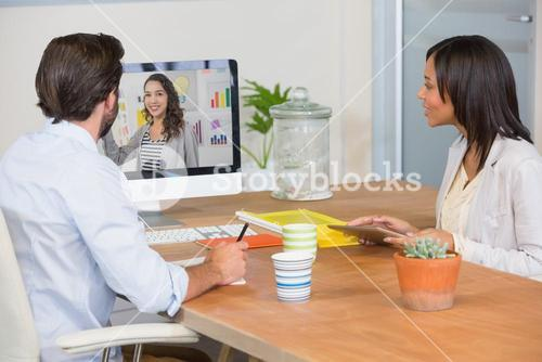 Two colleagues having a video conference