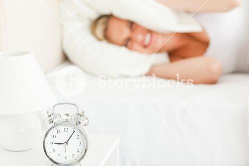 Angry blonde woman waking up
