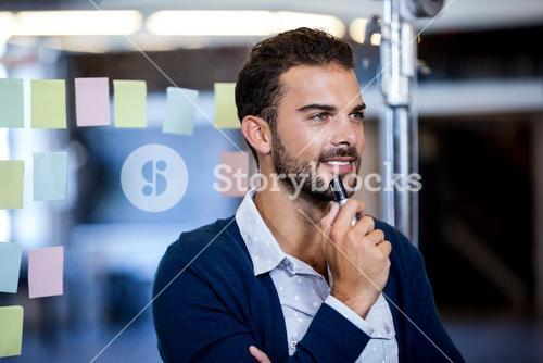 Businessman smiling and reflecting