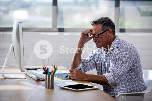 Businessman taking notes on a book