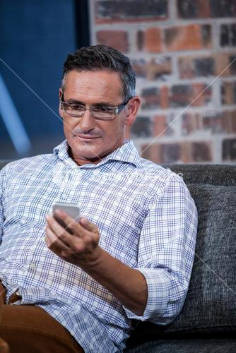 Close up of businessman looking his mobile phone