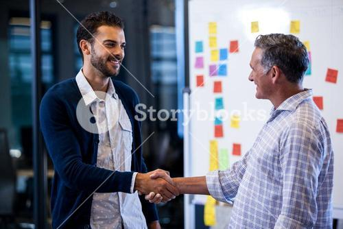Coworkers shaking hands