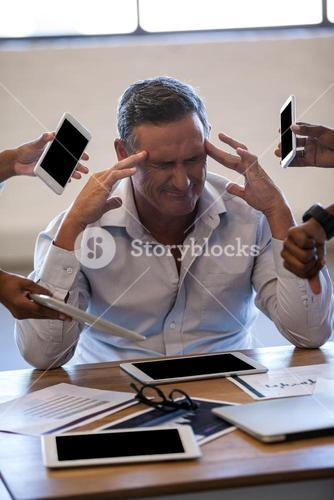 Overwhelmed businessman by his work