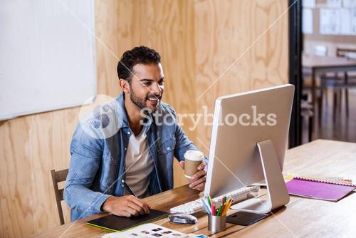 Businessman smiling and taking notes