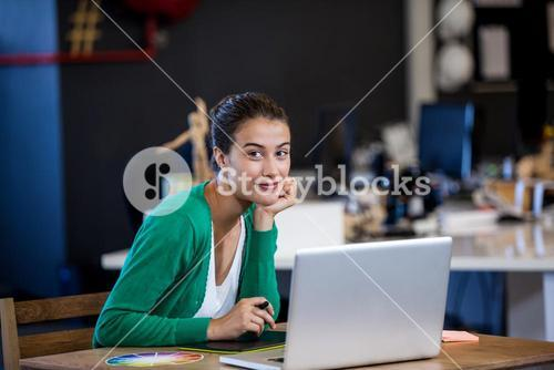 Businesswoman posing with her laptop