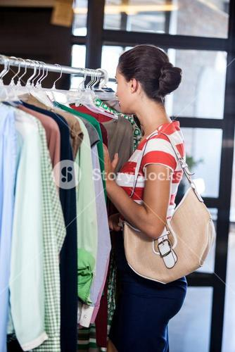 Profile view of businesswoman searching clothes