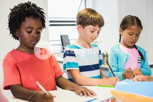 Kids studying in classroom