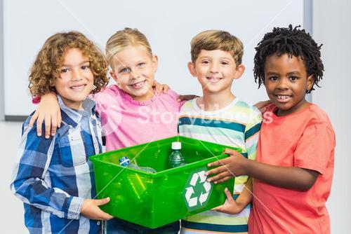 Kids holding recycled bottle in box