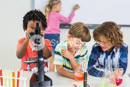 Kids doing experiment in laboratory